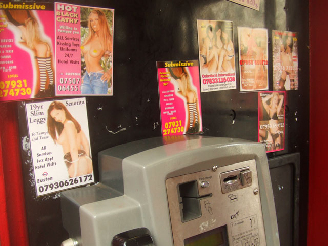 sex cards in a phone box