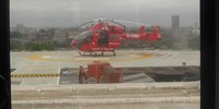 View of the London Air Ambulance from inside the helipad offices.