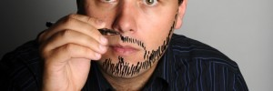 John Finnemore here, drawing a beard on himself