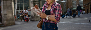 Hip reader, hip shooter outside Liverpool Street Station by Gary Kinsman