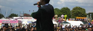 East London Mela performance with businesses & stalls background