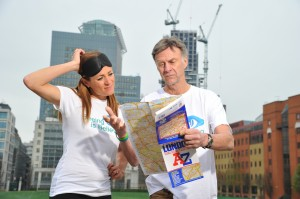 Natalie Pinkham and Sir Ranulph Fiennes check an A-Z