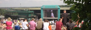 Spectators watching the big screen on Henman Hill / Murray's Mound