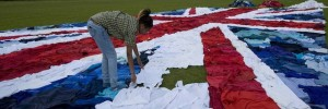 Marks &amp; Spencers creates World&#039;s largest Union Jack flag from unwanted clothes as part of its Shwopping initiative. 2,100 unwanted clothes were uses to create giant clothes mosaic in East London today.  Using 2,100 unwanted clothes items of clothes donated to the Shwopping initiative, Marks &amp; Spencers, local volunteers and charity partner Oxfam joined forces to make the worls&#039;s ;largest Union Jack.  Flag was created in a race against the clock to finish bbefore the winner of the 10km Open water Swi n at the Serpentine crosses the finish line   - London, Brita