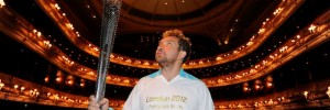 Actor Eddie Marsan holds the Paralympic Flame inside the Royal Opera House in London.