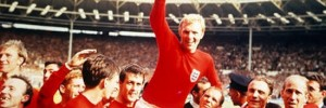 World Cup Final, 1966. Wembley, England. 30th July, 1966 England 4 v West Germany 2. Englands captain Bobby Moore holds aloft the Jules Rimet World Cup trophy as he sits on the shoulders of his teammates after the match.
